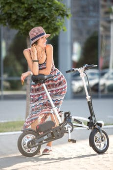 woman happy with her foldable electric bike