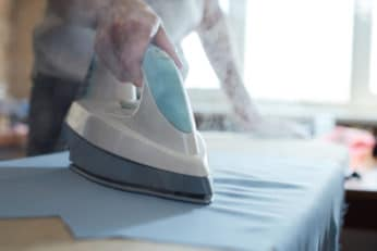 woman using a steam iron