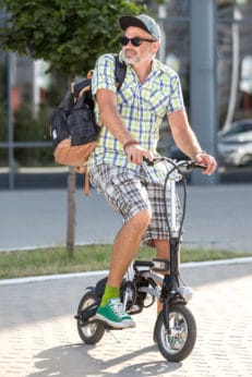 man riding an ebike to work