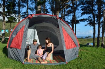 mum dad and child camping outdoors
