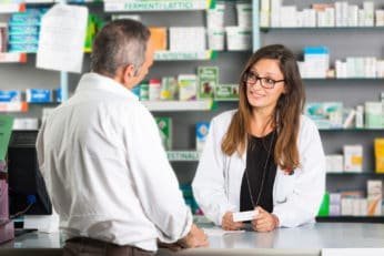 a pharmacist assisting a client