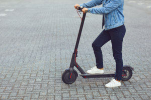 young man using scooter